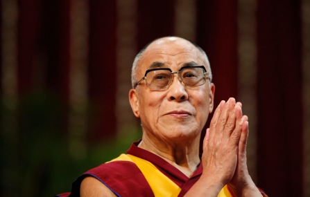 The Dalai Lama gestures before speaking to students during a talk at Mumbai University