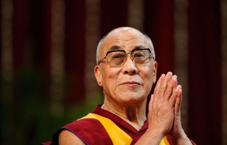 The Dalai Lama gestures before speaking to students during a talk at Mumbai University